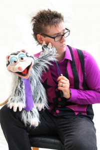 Magic puppet ventriloquist possum purple tie waistcoat black trousers silly funny